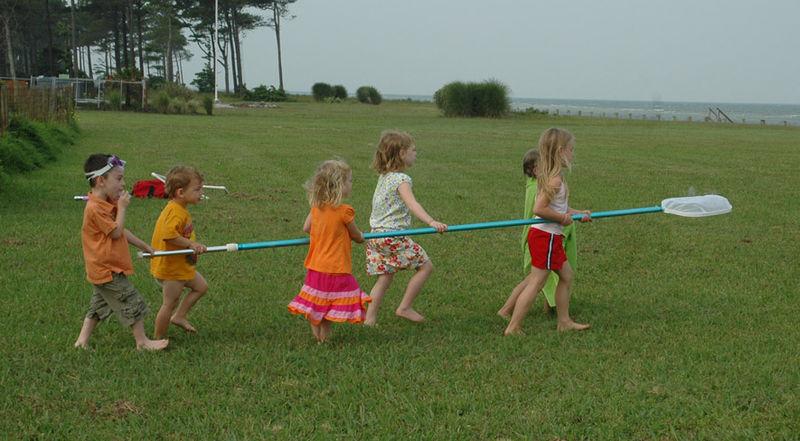 Kids return crab to the bay